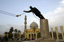 A statue of Iraq's President Saddam Hussein falls