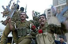 Cheering Iraqi soldiers head to the front